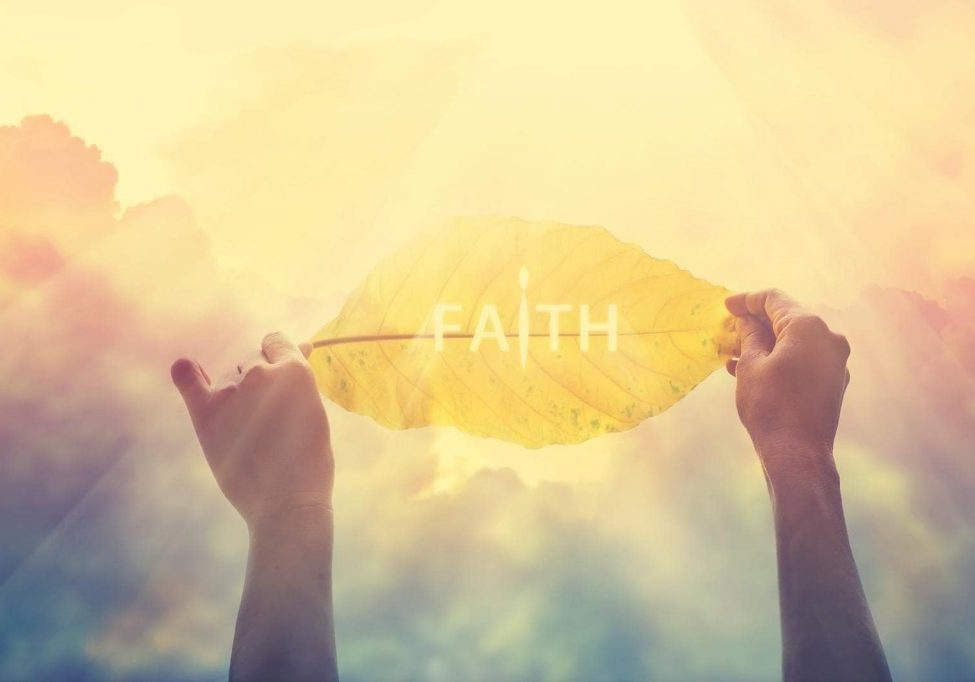 abstract, holding a yellow leaf in the clorful sky of faith, vintage color tone and soft focus